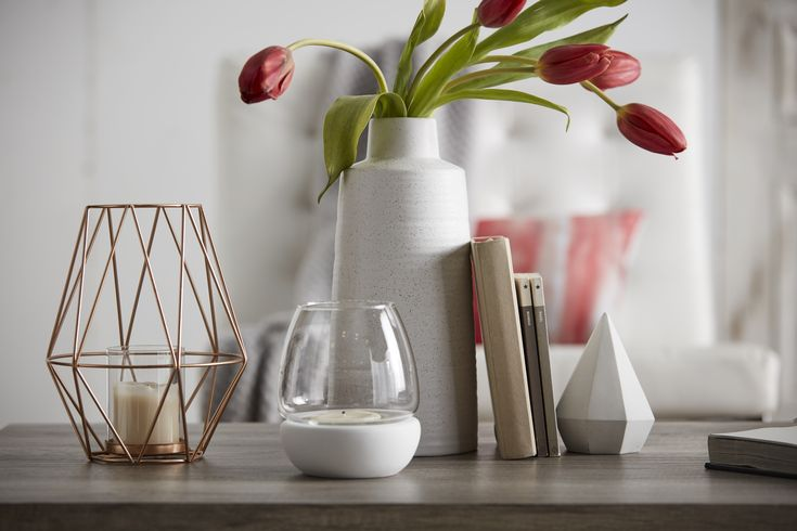 Setting a stylish scheme in any room is a snap when you've got great looking accessories like this ceramic vase. Clean lined and oh so modern, it's the perfect piece to showcase your decorating savvy. Display it on its own on a coffee table or end table or mix it in with other decorative objects as part of any eye-catching vignette on a console table, buffet or mantle.