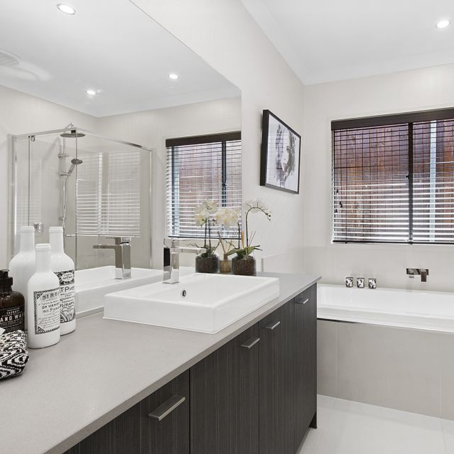 Create balance in your bathroom colour scheme with soft grey tones mixed with darker bold shades.  Bathroom by Metricon Homes (Bohemian 29RF Display Home)  http://www.metricon.com.au/  #Caroma #MetriconHomes #NewHomeIdeas #Bathroom #Design #Styling #ColourPallet #Benchtop #Bath #Basin #Tapware #BasinMixer #WeeklyHomeTrends  Caroma Liano Nexus Inset Basin http://www.caroma.com.au/bathrooms/basins/liano-nexus/liano-nexus-inset-basin