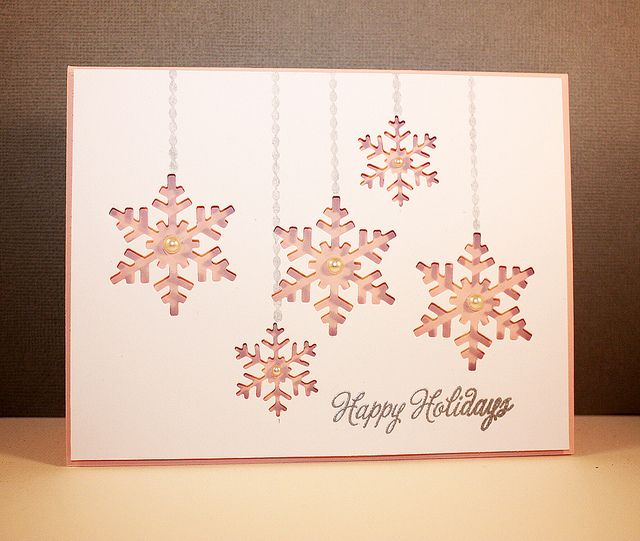 handmade Christmas card ... Festive Friday Challenge - Happy Holidays embossed in silver... snowflake negative punch outs backed with pink print paper ... pearls ... lovely!