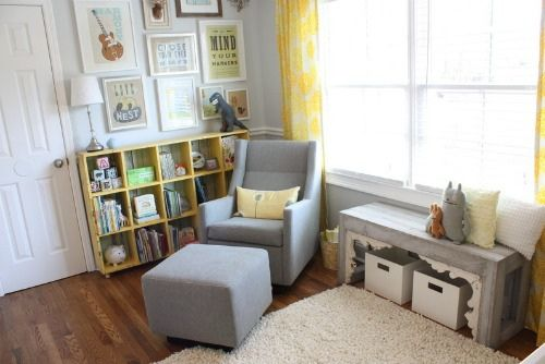 Lovely nursery with gray walls, yellow curtains. Great art arrangement.