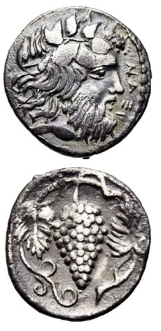The silver coin minted in ancient Naxos depicting the head of Dionysus and grapes shows the importance of wine culture in IV century BC. #sicily #history