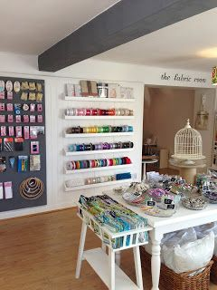 Millie Moon Haberdashery Boutique. Simple way of displaying ribbons, allows for them to be very accessible and clearly presented.