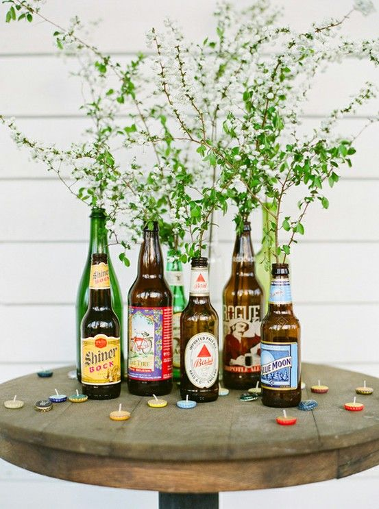 casual beer bottle floral arrangement for backyard BBQ wedding