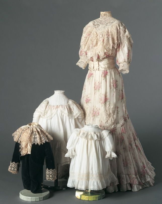 Dress, c. 1905    Cotton mull, lace, silk satin ribbon    American  An immaculately dressed wife and children were visible symbols of a man's success at the turn of the twentieth century. An upper-class women managed the good running order of their home with the assistance of nannies, maids, cooks, and butlers, all worked under her supervision to maintain proper standards for the family. Here, the delicate batiste fabric and lace of the woman's dress assure that she is not directly involved…