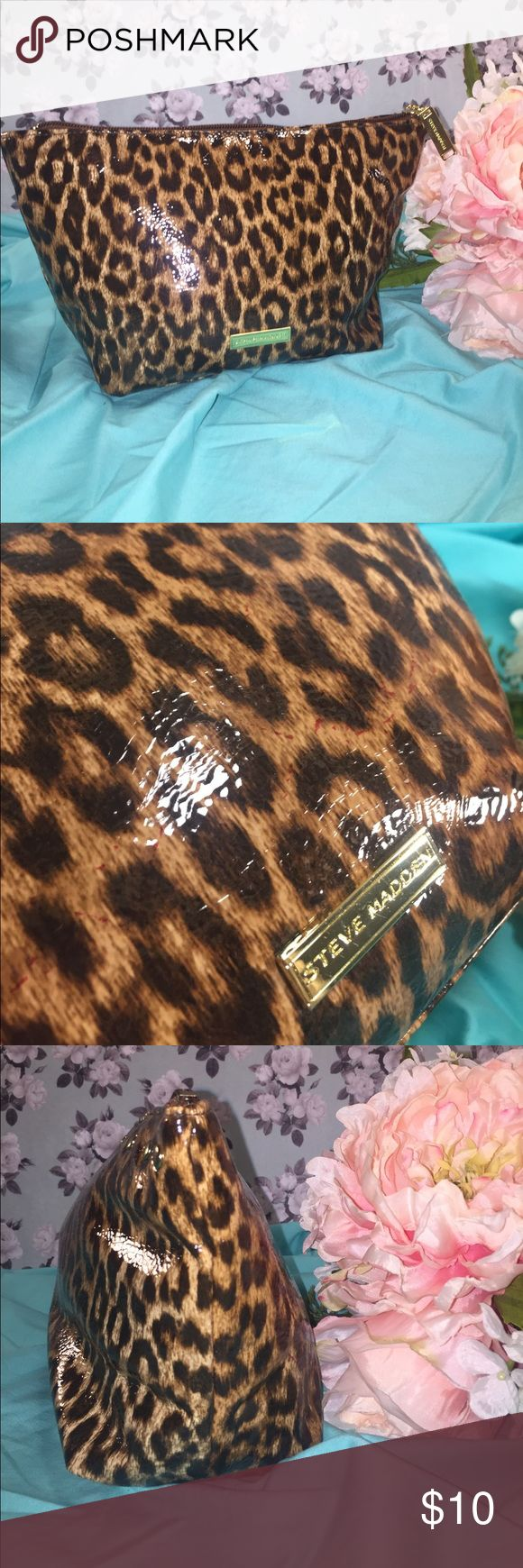 "STEVE MADDEN Cheetah Travel Bag STEVE MADDEN Cheetah Travel Bag in black, brown, and tan with gold tone hardware, stud detailing, Steve Madden plaque and zipper pull, top zip closure, brown interior lining with one zip interior pocket. Excellent preowned condition. Measures 11 x 6.5 x 4"". Orig. $24.99 Steve Madden Bags Cosmetic Bags & Cases"