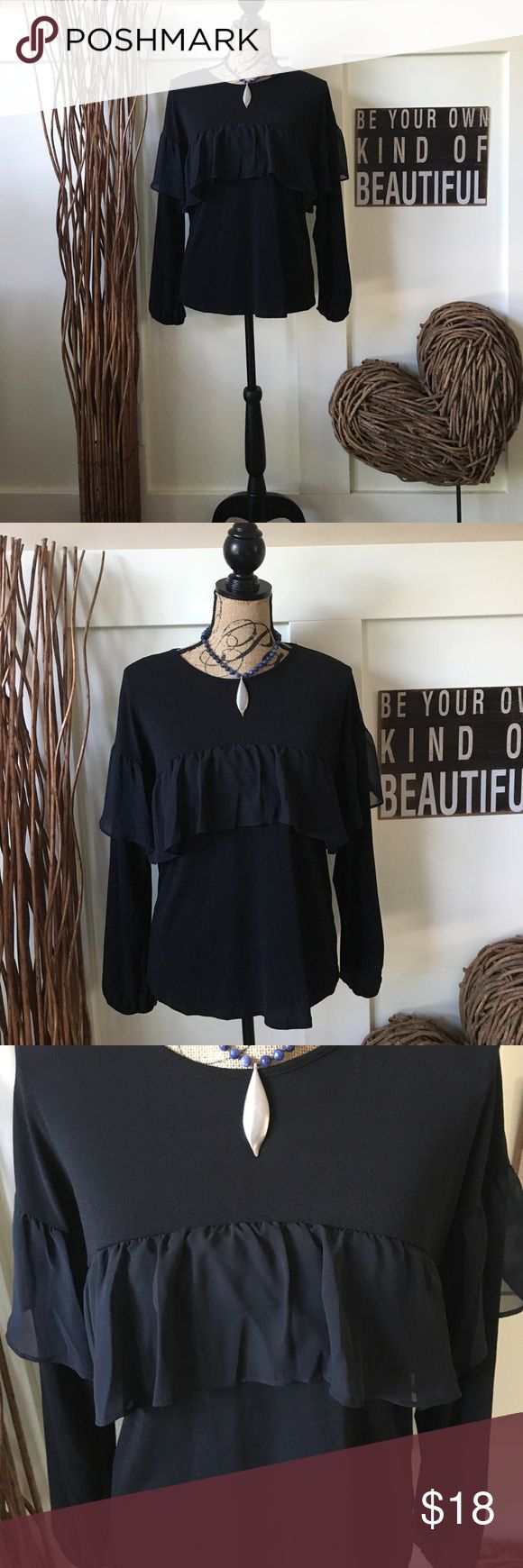 ELLE pretty long sleeve black top with ruffle This  pretty black top has a sheer ruffle across the bust  line and around each arm at the shoulder.  The  top has a full sleeve with elastic wrists and is feminine and oh so pretty. Elle Tops