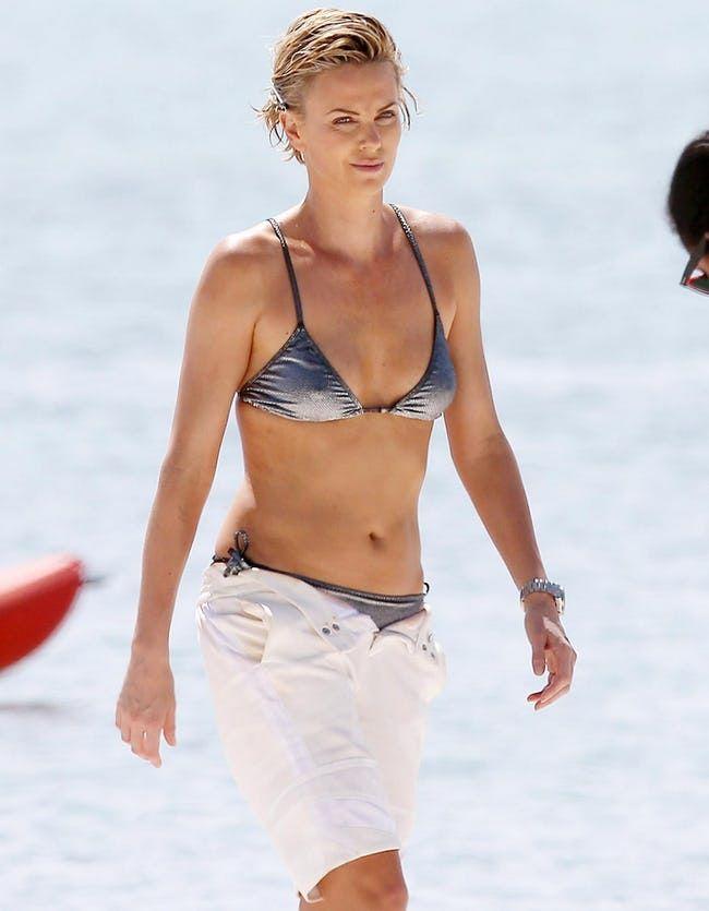 Charlize Theron with her shiny silver bikini.