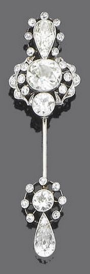 A belle époque diamond sûreté pin, circa 1910 Each finely pierced terminal millegrain-set with cushion, pear-shaped, old brilliant and single-cut diamonds, diamonds approx. 5.00ct. total, length 6.5cm.