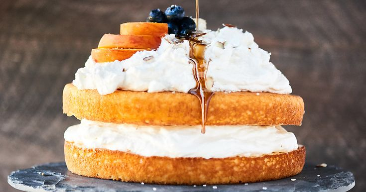 Chardonnay Caramel Cake: an easy, flavorful, moist vanilla cake topped with lightly sweetened fluffy whipped cream, and a rich, buttery caramel sauce.