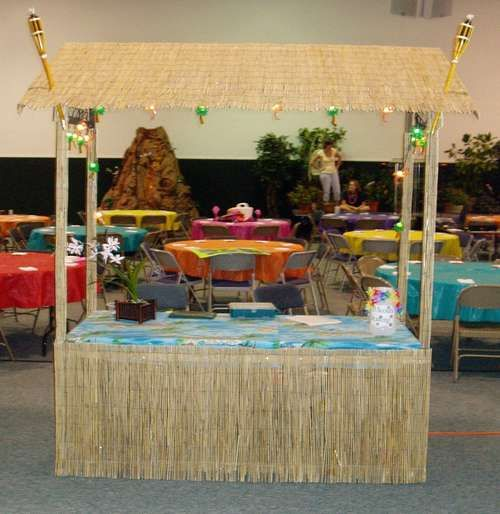 How to build a tiki bar luau buffet table pinterest for Tiki decorations home