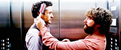 "Zach Galifianakis brushes Robert Downey Jr.'s hair, between takes on ""Due Date."""