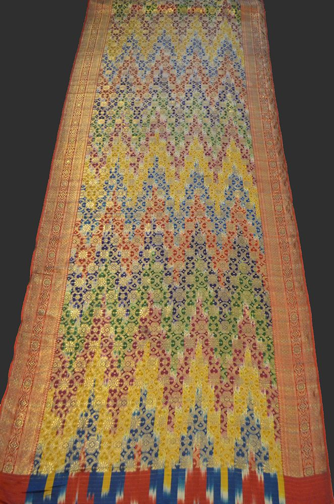 sari. a sari, with different intricate flower motifs on the central part and the side edges. overall design resembles chains of multi-coloured mountains. Varanasi, India – 19th c pure silk.