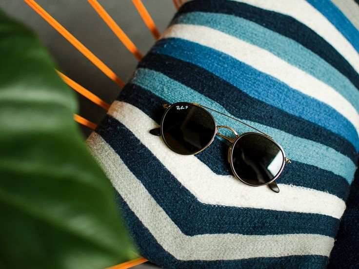 Spending Sunday as your vacation from the vacation laying poolside in Ray-Ban sunglasses.