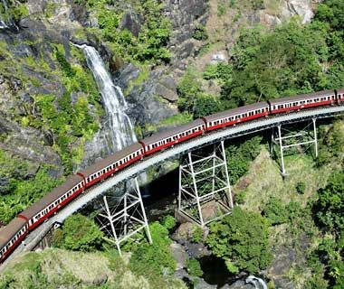 "Kuranda Scenic Railway, Australia *  The railway has ""Scenic"" in its name, but ""Vertiginous"" could also have made the cut. Carved into the dense tropical rainforest in the late 1800s, the Kuranda crosses dramatic trestles, winds past gushing waterfalls, and traverses the sea-deep Barron Gorge National Park in the hour and 45 minutes it takes to get from Cairns to Kuranda. The train runs three times daily, 364 days a year"