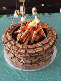 Camp Fire  Cake! Fire pit cake, roasting marshmallows, Glamping. The sides are sliced candy bars, the fire is colored white chocolate.