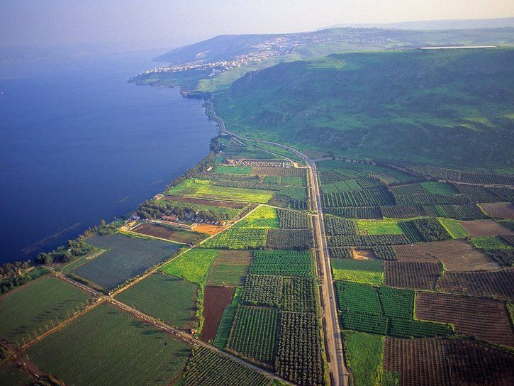 A magnificient aerial view of the Sea of Galilee with the city of Tiberias in the background.