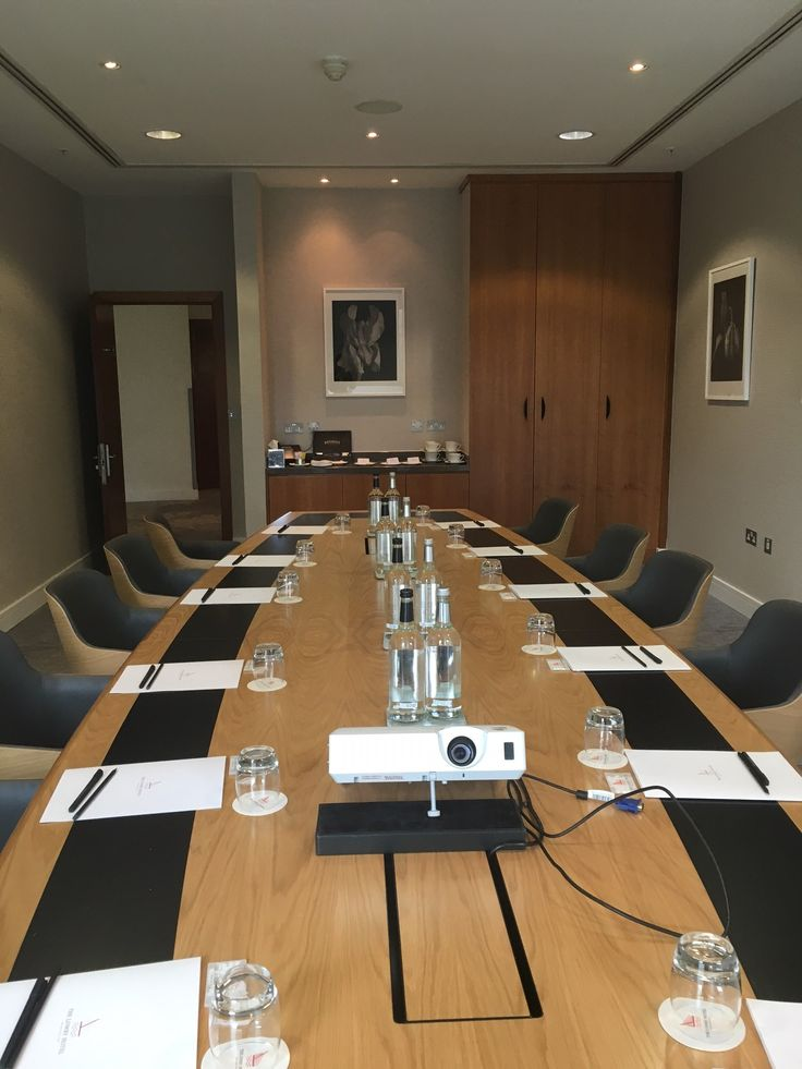 The Lowry Hotel's new fancy boardroom can seat up 12 guests in bucket chairs around a fixed table.