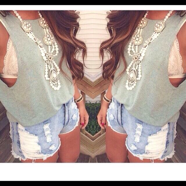 Statement neck lace, cutoff shirt, Lacie bra, and high waisted shorts