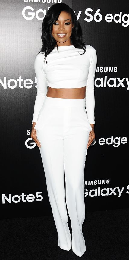 Gabrielle Union was white-hot at the Samsung Galaxy S6 edge+ launch in a long-sleeve white crop top and sleek tailored wide-leg pants. #celebrity #fashion