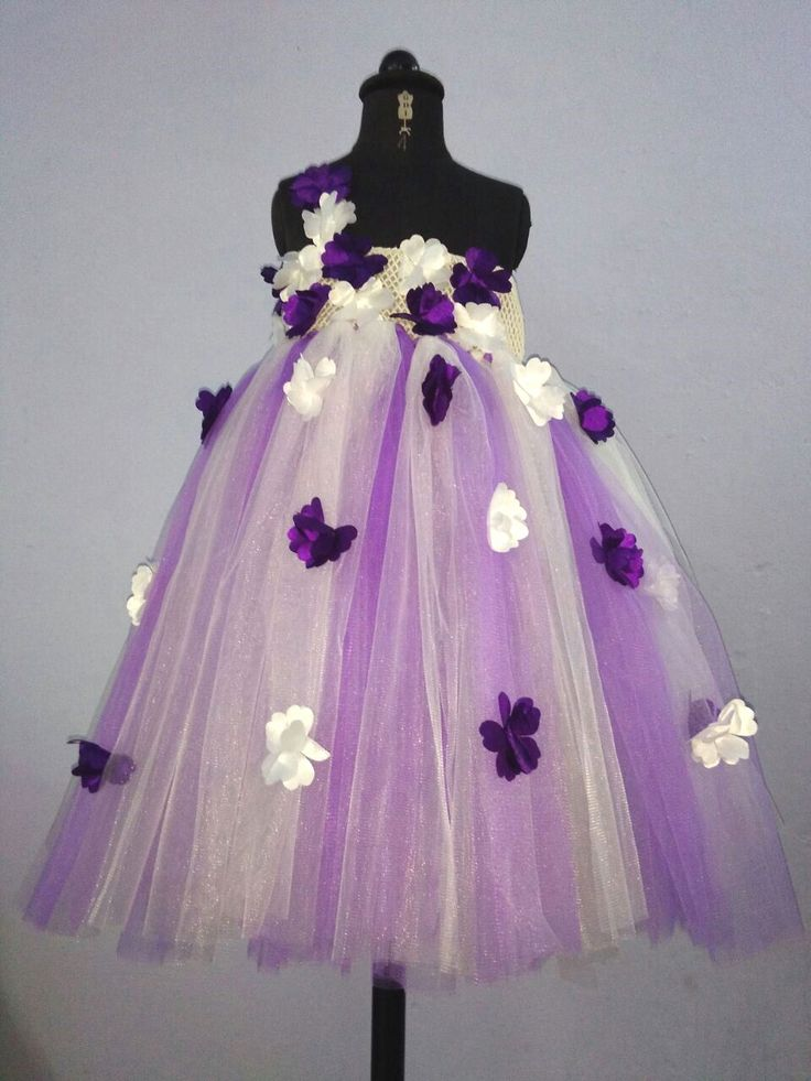 http://www.foreverkidz.in/Girls-Party-Wear/Purple-Flower-Tendril-Tutu-Gown--With-Head-Band--id-2209030.html