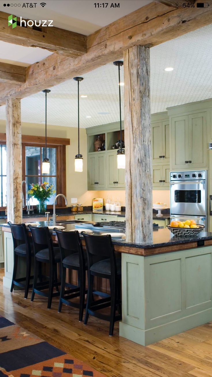 Natural wood columns on either side of island, plus header