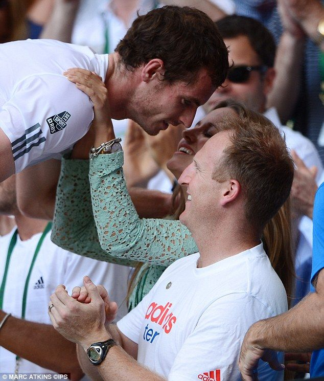 Andy Murray gets a kiss from his girlfriend Kim Sears after becoming Wimbledon mens champion 2013
