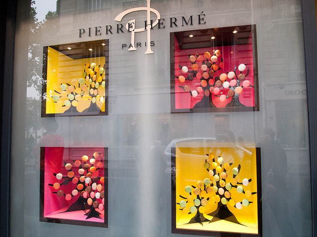 love the color display...could be raspberry and or shades of plum...perhaps along the side walls above the hanging display cases you already have?