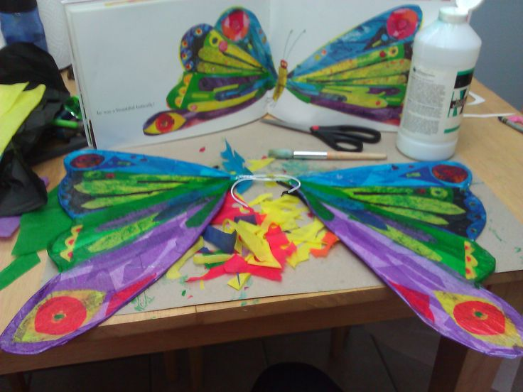 """Material to make butterfly wings:  The Very Hungry Caterpillar book (for reference), two wire hangers, pliers, one white large poster board, black, dark blue and light blue, yellow, red, green, and purple tissue paper (might have left some colors out); scissors, a few strips of tape, paint brush, clear varnish (typically used to protect paintings) or glue, three ft. of elastic.  Put them all together and you are """"a beautiful butterfly""""! -Irasema"""