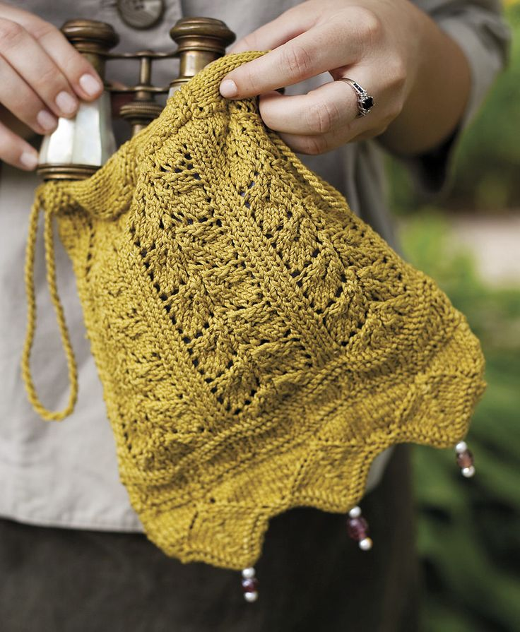Knitting Pattern for Netherfield Evening Bag - Inspired by the ball scene in Pride and Prejudice and Regency era evening wear, this reticule features leafy vine and wave lace. About 8″ wide and 9″ tall.