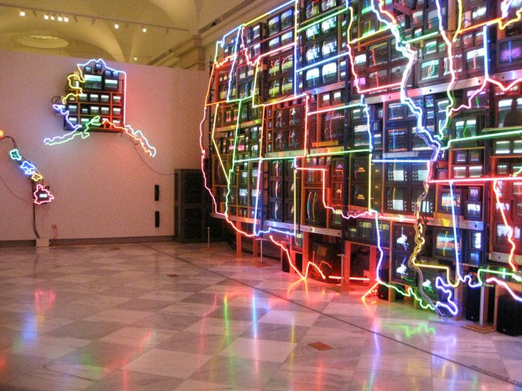 Nam June Paik creates a cultural map of the United States using neon and video