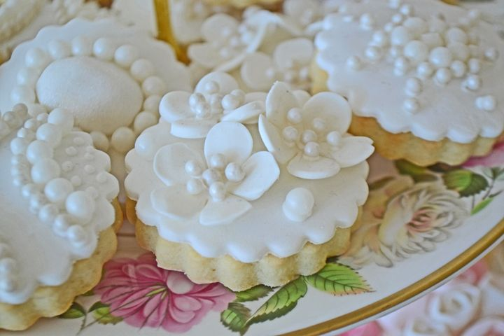 Brooch sugar cookies for a vintage themed dessert table. Cookies by Bake Sale Toronto. China from Vintage Dish Rental.