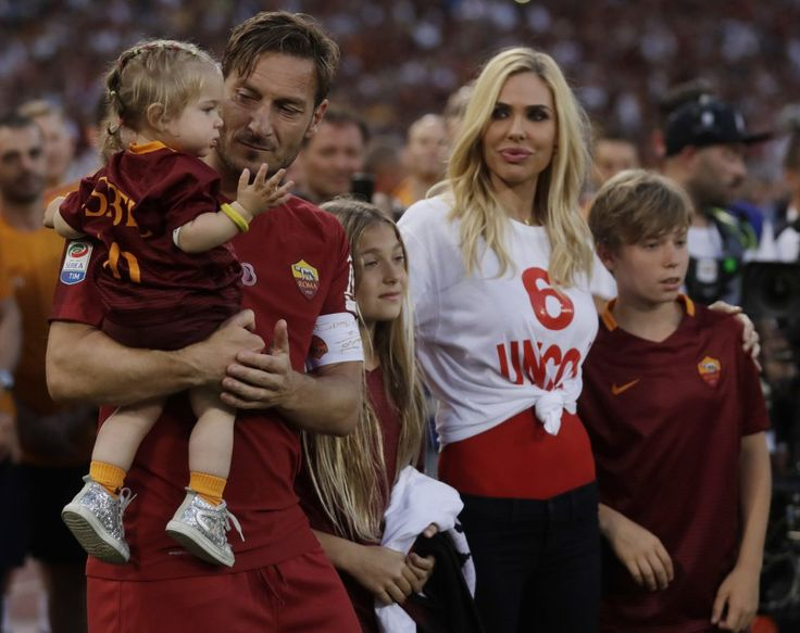 The Totti family - baby Isabel, proud papa Francesco, Chanel, Ilary, and Cristian.