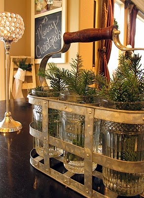 Good idea for adding a sprig of evergreen...love the vintage carrier and the old glasses