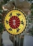 """Horse Race Wheel.  The Horse Race Game includes a Mat consisting of 6 lanes as well as 6 horses.  This is a new take on the wheel games and very popular if you want something """"different""""."""