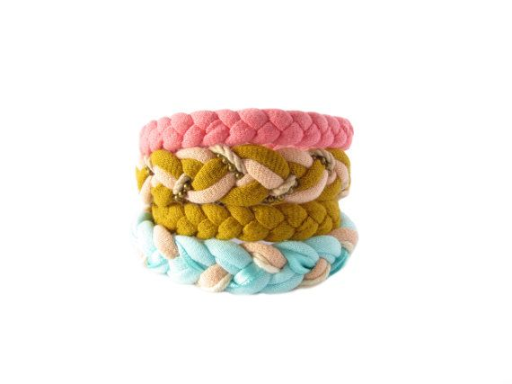 Handmade colorful fabric bracelets made from cotton t-shirt yarn, satin ribbon, ropes and a bronze ball chain.
