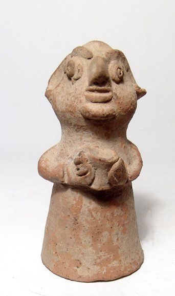 Mohenjo Daro terracotta fertility idol, Indus Valley, 2500-1500 B.C. Representing a male, the body conical with large head possessing exaggerated features and holding a vessel against his chest, 11.5 cm high. Private collection