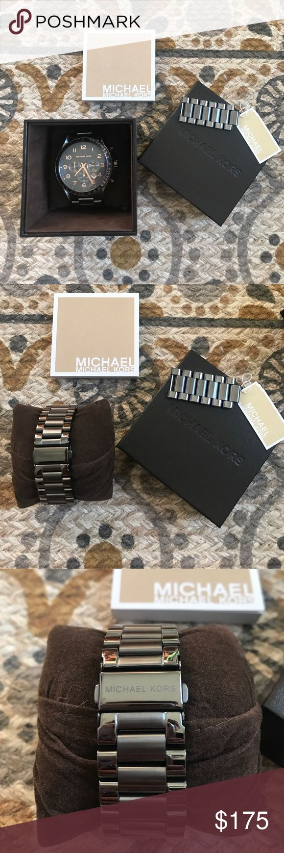 🎉Brand New Michael Kors Watch🎉 Woman's Oversized All Stainless Steel Black and Rose Gold Michael Kors watch! Includes is the original tag, extra latches, instruction manual and original box. Michael Kors Accessories Watches