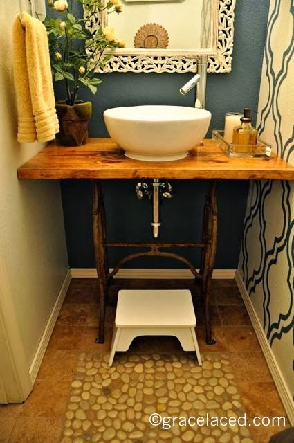 gorgeous antique sewing machine base into rustic bathroom vanity, how cool is this!