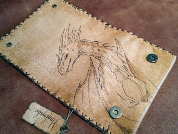Genuine Leather Tobacco Pouch in natural color. Τhe leather has been treated so that it looks like old paper. The dragon was burnt with a pyrographer. It has internal pockets for rolling papers and filters and it closes with magnetic snaps    Dimensions: 145mm x 200mm.    The item is 100% handmade.