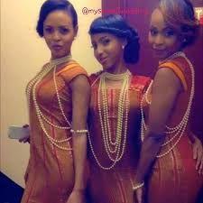 Three Somali women in traditional dress