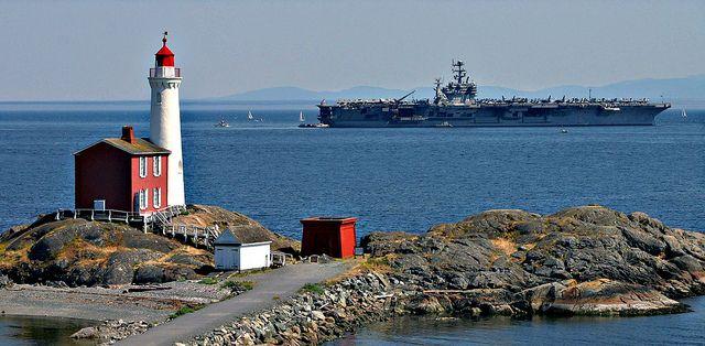 Fisgard Lighthouse in Victoria, BC Canada and USS John C. Stennis (CVN 74).