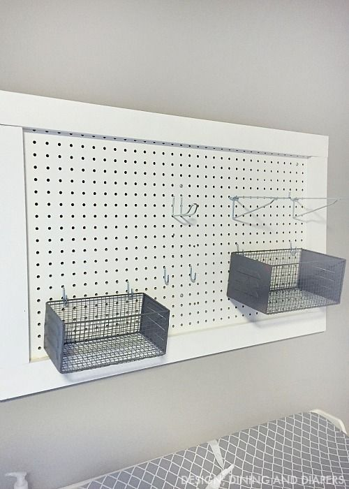 Pegboard Diaper Changing Station w/ National Hardware pegboard hook assortment | Design Dining and Diapers