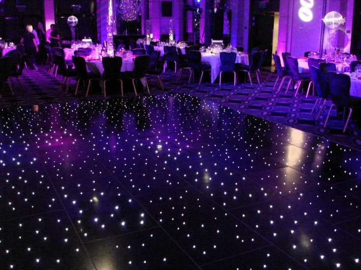 Wicked dance floor, with walls that are made of many borderless TV screens, the floor of light up tiles for special effects and stuff, ambient light, smoke machines, strobes, the works, everything you would need to throw it down however you wanted