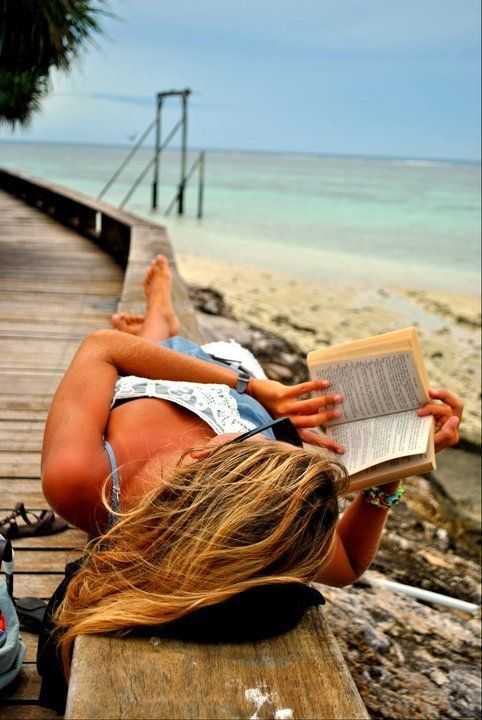 Breezy Summer Day Relaxing with a Book at the Beach by the Ocean