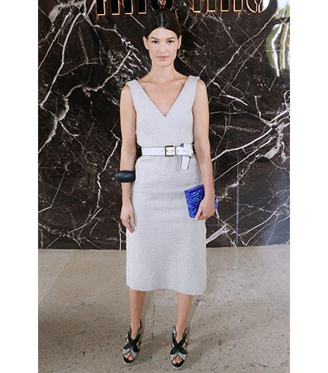 Hanneli Mustaparta punched up her understated gray Calvin Klein frock with a pair of Chrissie Morris shoes, a chunky Cara Croninger bangle, and an Acne Akoya Cobalt Blue Clutch at the Miu Miu show.
