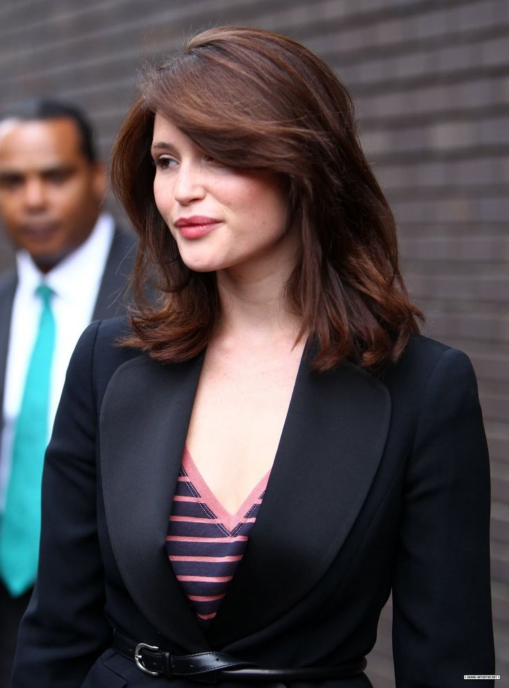 Gemma Arterton. A gorgeous natural looking shade. It gives the hair great dimension and the cut gives great movement
