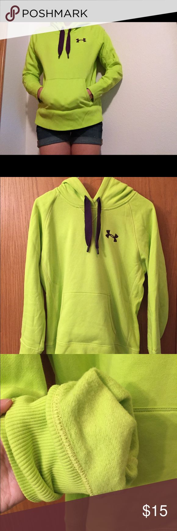 Under Armour neon green and purple hoodie Bright green and purple women's hoodie, size XS. Very comfy and cozy. Small mark on lower back, as shown in the picture. Only worn a couple of times Under Armour Tops Sweatshirts & Hoodies