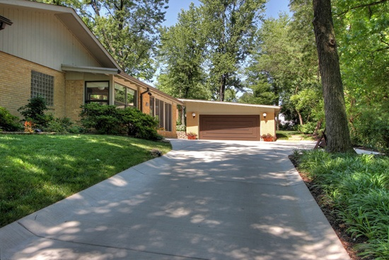 A poured concrete driveway with built in gutters just one for Pouring concrete driveway