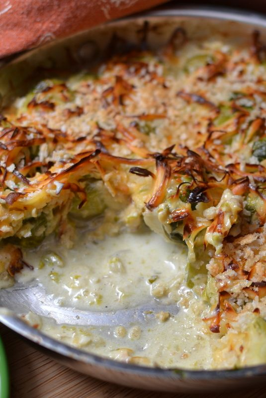 This Quick Brussels Sprouts Au Gratin combines Brussels sprouts, onions, garlic, cream, Parmesan, cheddar and Gouda in a quick to fix skillet to oven dish.