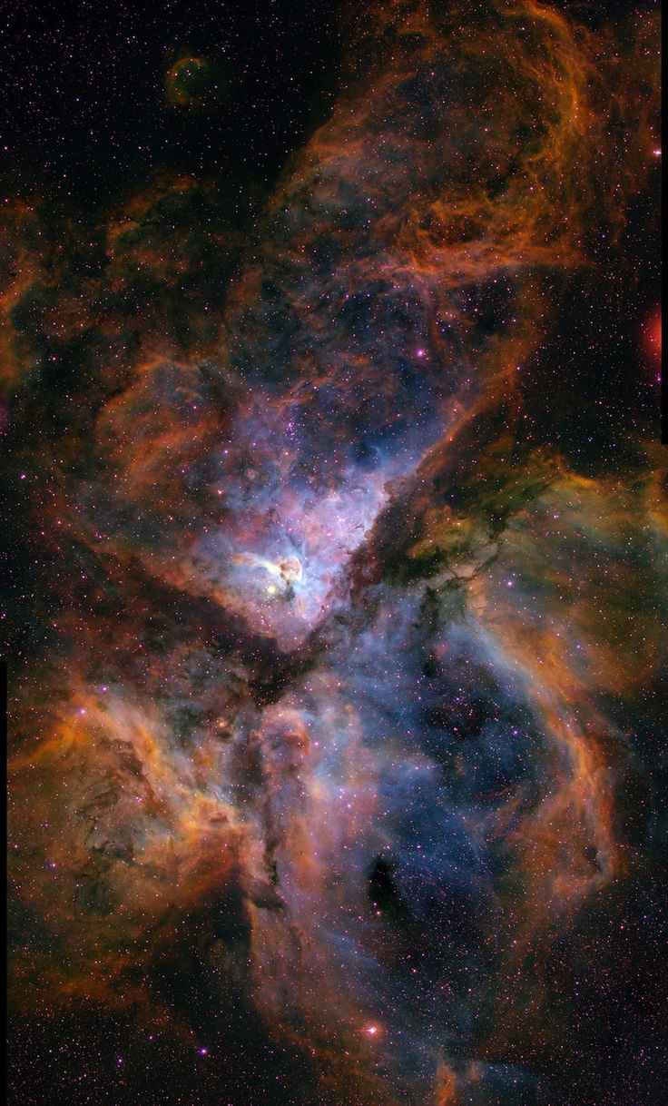 Sweeping View of Carina-    This image shows a giant star-forming region in the southern sky known as the Carina Nebula (NGC3372), combining the light from 3 different filters tracing emission from oxygen (blue), hydrogen (green), and sulfur (red). The color is also representative of the temperature in the ionized gas: blue is relatively hot and red is cooler.  mage: Nathan Smith, University of Minnesota/NOAO/AURA/NSF [high-resolution]